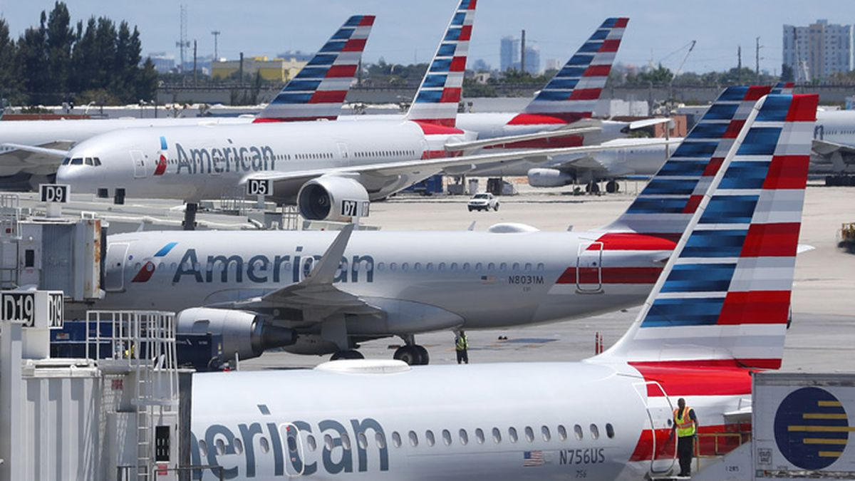 FILE - In this April 24, 2019, photo, American Airlines aircraft are shown parked at their gates at Miami International Airport in Miami. An American Airlines mechanic is accused of sabotaging a flight from Miami International Airport to Nassau in the Bahamas, over stalled union contract negotiations. Citing a criminal complaint affidavit filed in federal court, The Miami Herald reports Abdul-Majeed Marouf Ahmed Alani was arrested Thursday, Sept. 5, 2019, on the sabotage charge and is accused of disabling the flight's navigation system. (Source: AP Photo/Wilfredo Lee, File)