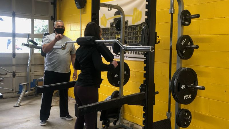Basic weightlifting using a safety rack