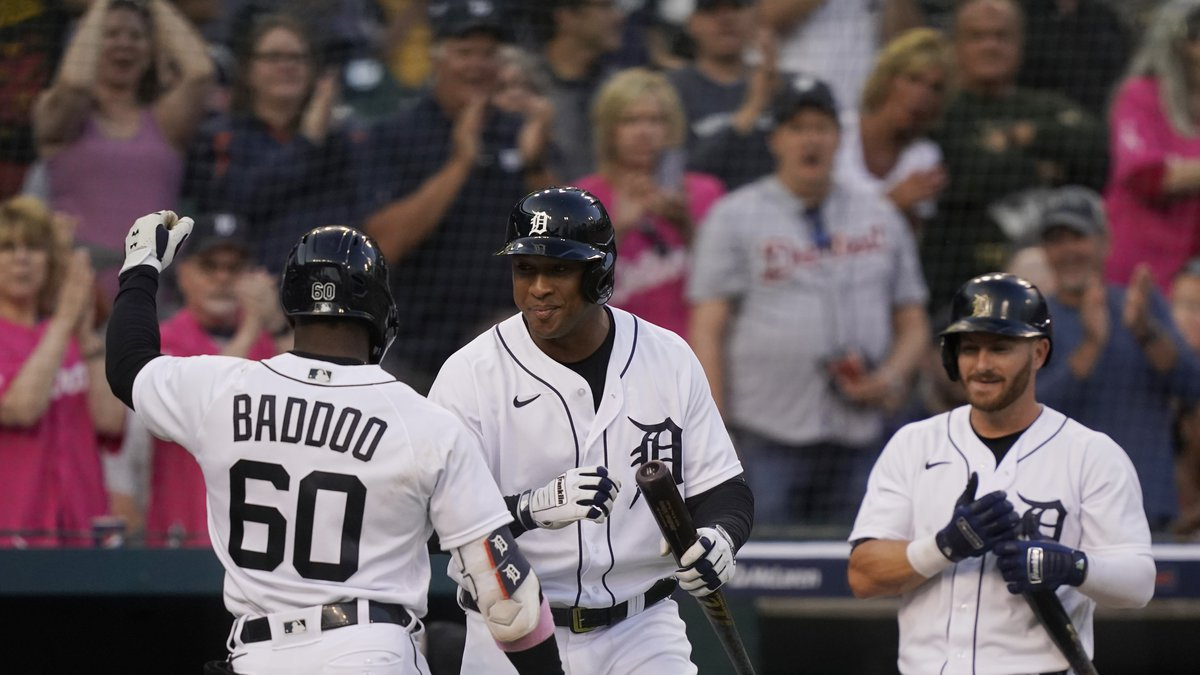 Detroit Tigers' Akil Baddoo (60) is greeted at the dugout by Jonathan Schoop, and Robbie...