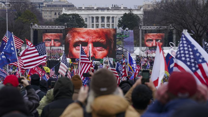Trump supporters participate in a rally Wednesday, Jan. 6, 2021 in Washington. As Congress...