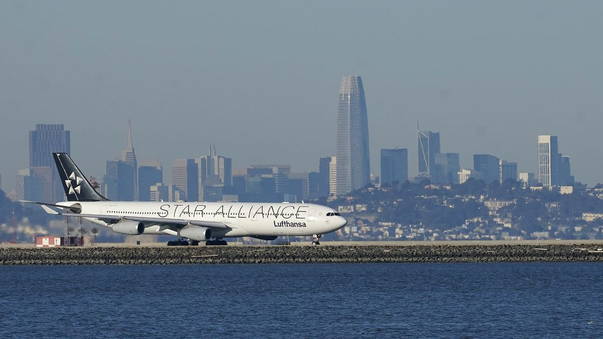 FILE - In this Tuesday, Dec. 22, 2020 file photo, A Lufthansa Star Alliance plane prepares to...