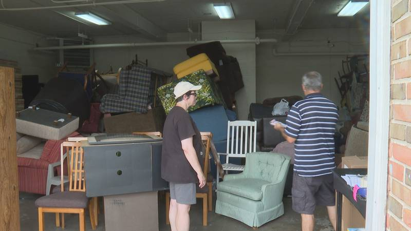 Organizers receive donations for Afghan refugees.