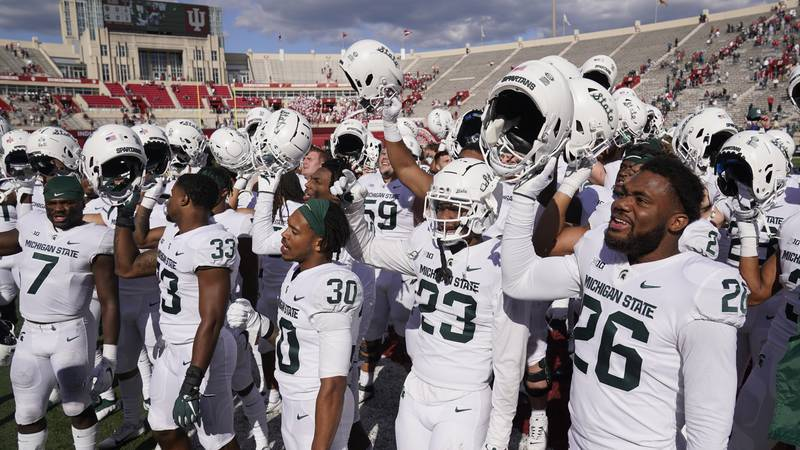 Michigan State players celebrate following an NCAA college football game against Indiana,...