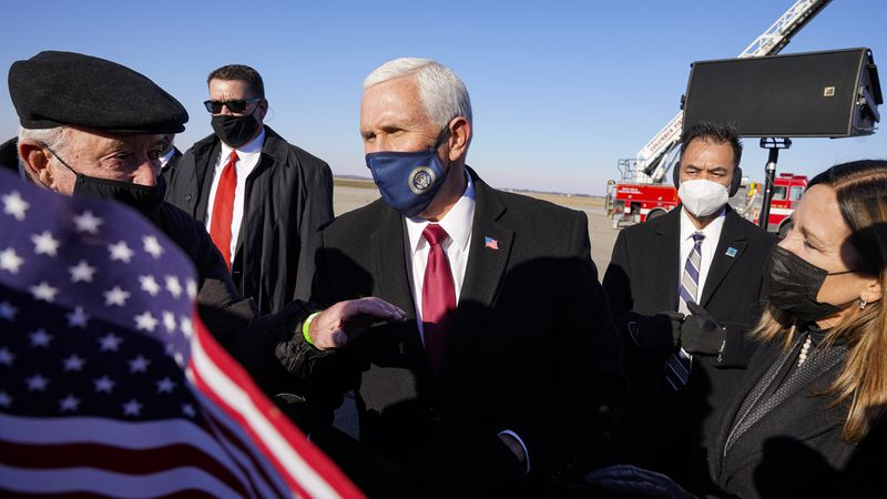 FILE - In this Jan. 20, 2021, file photo, former Vice President Mike Pence greets supporters...