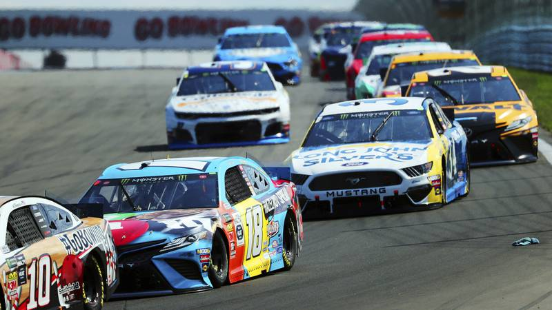 FILE - Kyle Busch (18) heads into Turn 1 during a NASCAR Cup Series auto race at Watkins Glen...