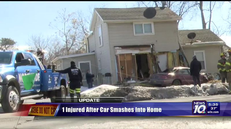 1 injured after car smashes into home