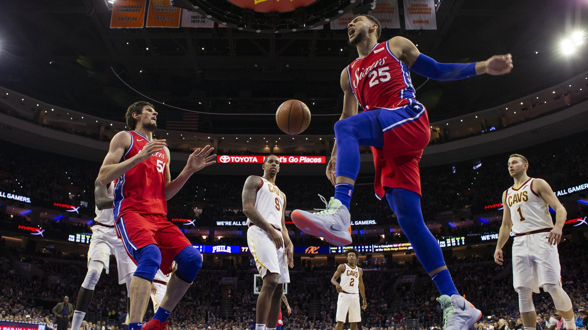 Philadelphia 76ers' Ben Simmons, right, of Australia, reacts to his dunk during the second half...