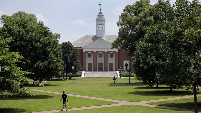 FILE - In this In this July 8, 2014 file photo, people walk on Johns Hopkins University's...