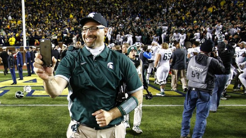 Former MSU Assistant Coach Mark Staten celebrates after a Spartan victory.