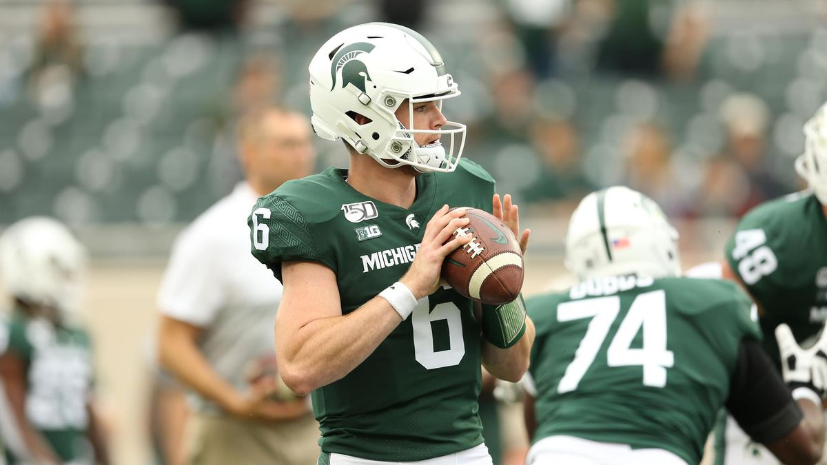 Michigan State Quarterback Theo Day warms up before a game.