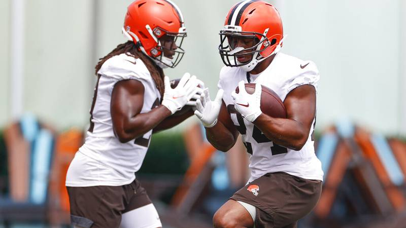 Cleveland Browns running back Nick Chubb (24) and running back Kareem Hunt (27) run through a...