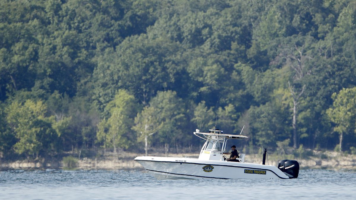 A state trooper patrols an area Friday, July 20, 2018, near where a duck boat capsized the night before resulting in at least 13 deaths on Table Rock Lake in Branson, Mo. Workers were still searching for four people on the boat that were unaccounted for. (AP Photo/Charlie Riedel)