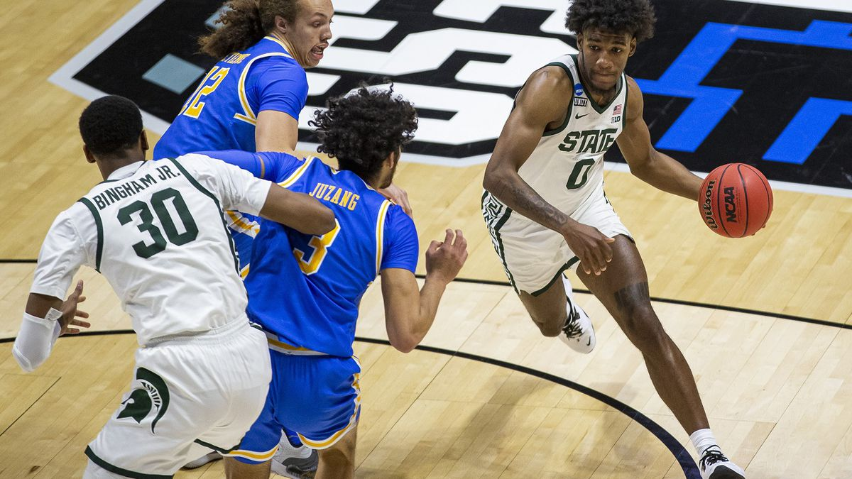 Michigan State's Aaron Henry (0) drives near teammate Marcus Bingham Jr. (30) as UCLA's Mac...