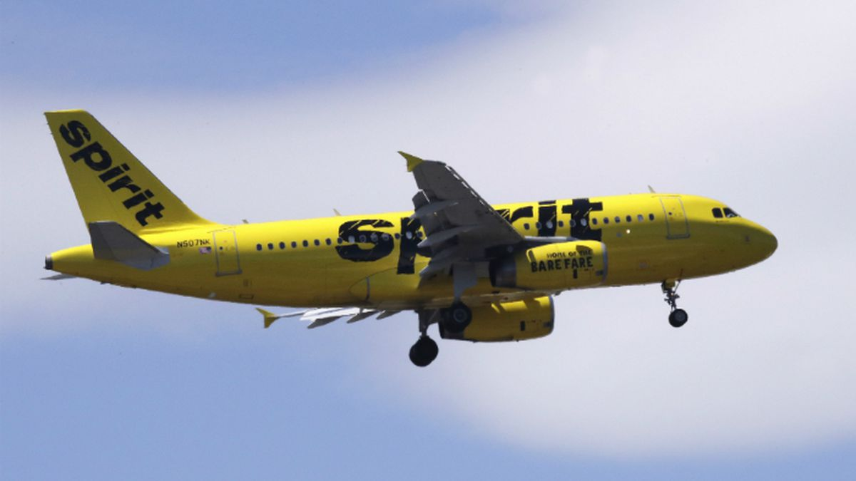 File-This May 24, 2018, file photo shows a Spirit Airlines passenger jet plane, an Airbus 319 model, approaching Logan Airport in Boston. Spirit Airlines tops the latest ratings for on-time flights, a stunning turnaround for a discount carrier that consistently ranked as the tardiest airline in America three years ago. The Transportation Department said Friday, Dec. 14, 2018, that 89 percent of Spirit's flights in October arrived on time, putting Spirit just ahead of frequent winner Hawaiian Airlines and Delta. (AP Photo/Charles Krupa, File) (Source: Charles Krupa)