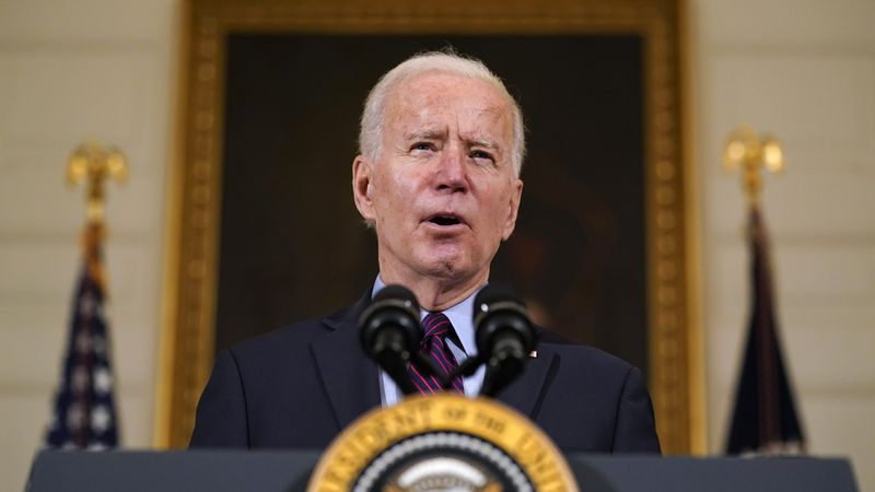 FILE - In this Friday, Feb. 5, 2021 file photo, President Joe Biden speaks in the State Dining...