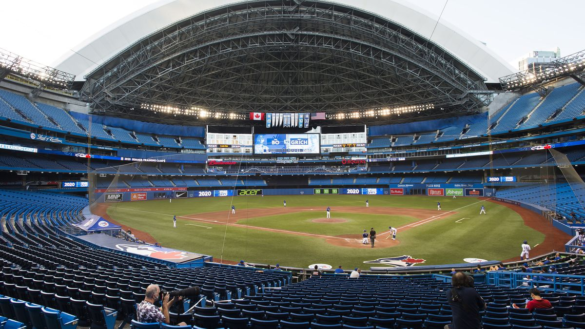 Photographers cover the game in an empty stadium during fourth-inning intrasquad baseball game action in Toronto, Friday, July 17, 2020.