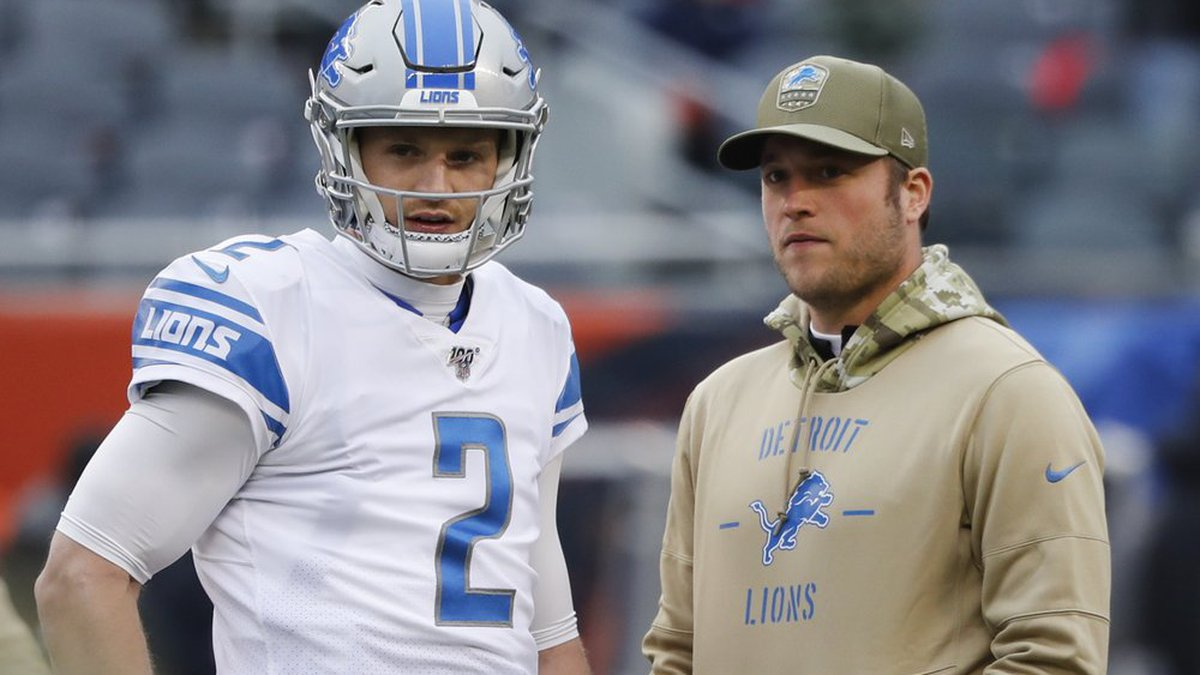 Detroit Lions quarterback's Jeff Driskel (2) and Matthew Stafford watch during warmups before...