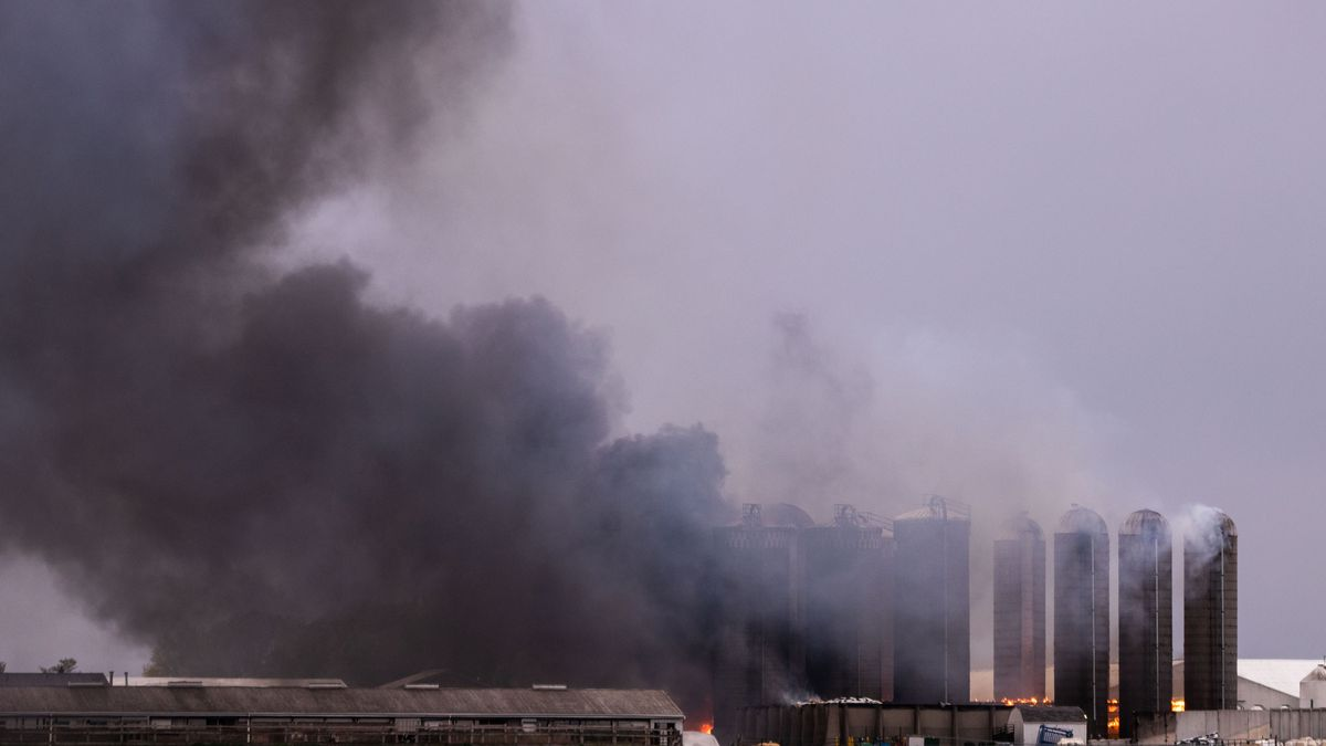 Crews battle a fire that broke out at the Michigan State University's Dairy Cattle Teaching and...