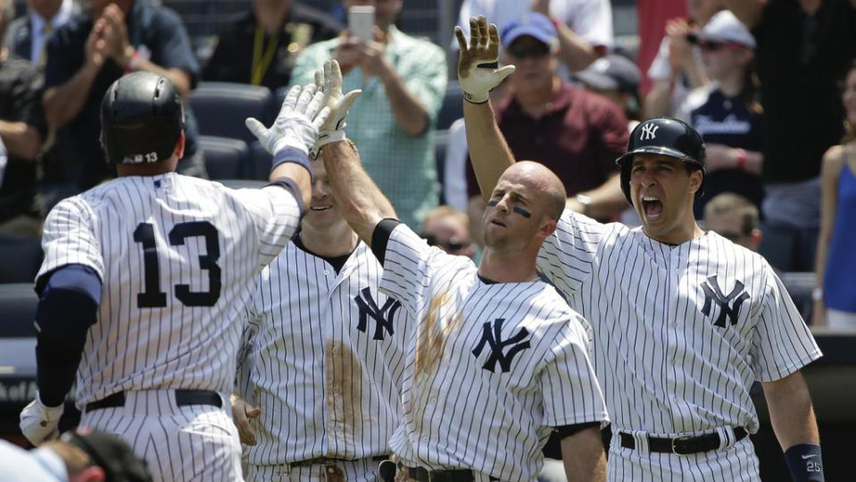 New York Yankees designated hitter Alex Rodriguez (13) is greeted by Brett Gardner, Mark...