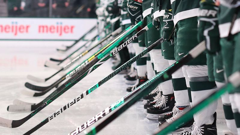 Michigan State Hockey players stand on the blue line during the national anthem before an...
