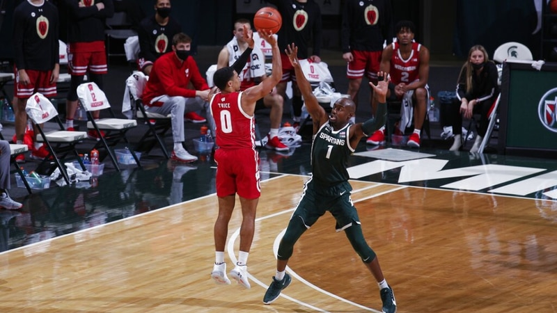 (AP) Wisconsin's D'Mitrik Trice, left, shoots against Michigan State's Joshua Langford during...