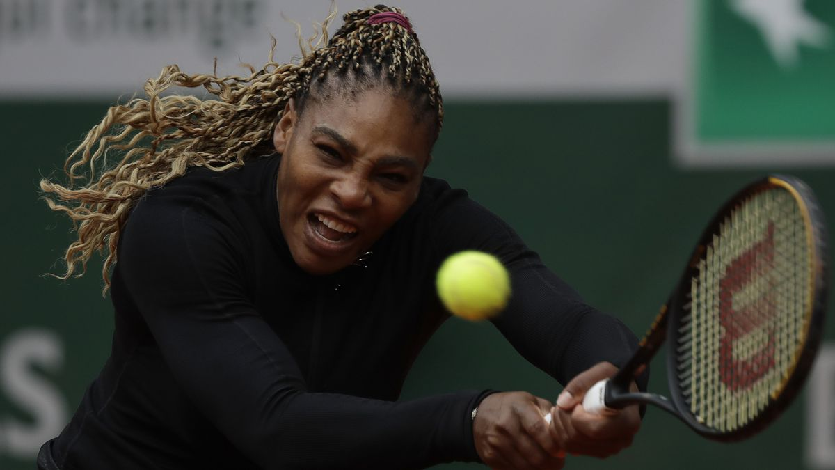 Serena Williams of the U.S. plays a shot against Kristie Ahn of the U.S. in the first round match of the French Open tennis tournament at the Roland Garros stadium in Paris, France, Monday, Sept. 28, 2020.