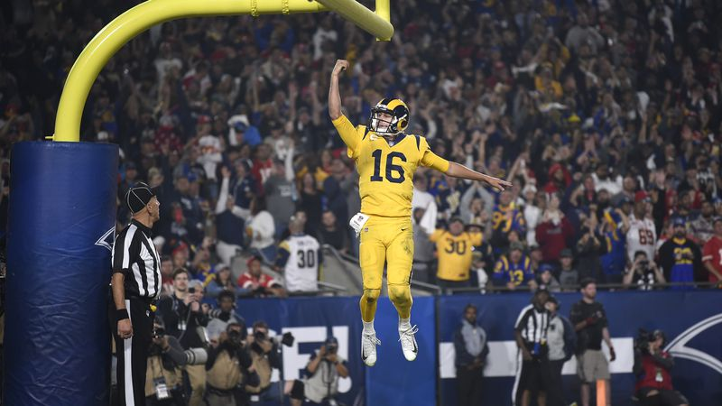 Los Angeles Rams quarterback Jared Goff celebrates after scoring a touchdown against the...