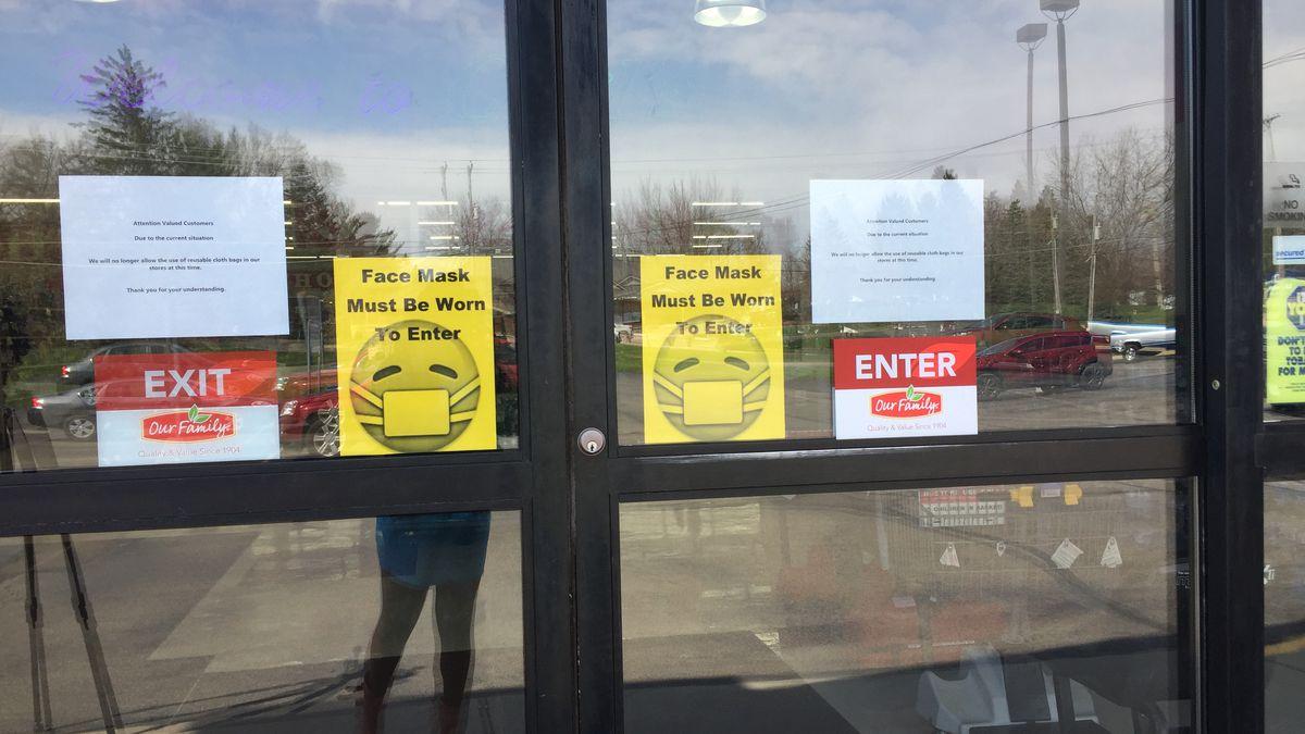 Door signs at Carl's Supermarket.