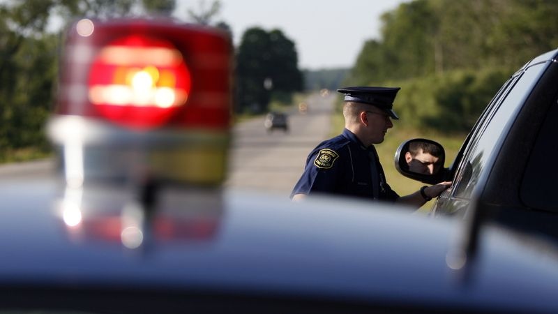 A Michigan State Police trooper pulls over a driver for a traffic violation. (MSP Photo)
