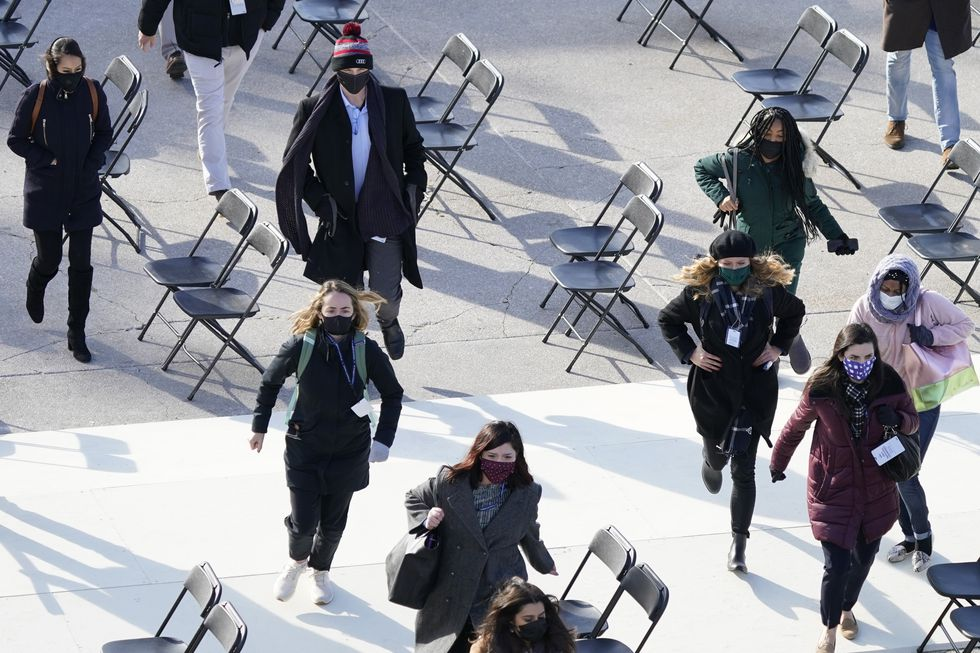 People evacuate from the West Front of the U.S. Capitol during a rehearsal the 59th...