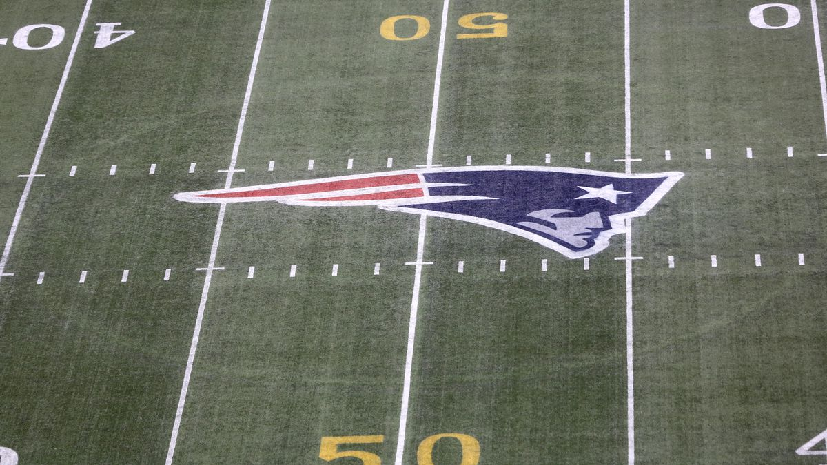 The gold 50 yard marker and Patriots logo is seen on the filed before the New England Patriots play against the Pittsburgh Steelers during an NFL football game, Thursday, Sept. 10, 2015, in Foxborough, Mass.