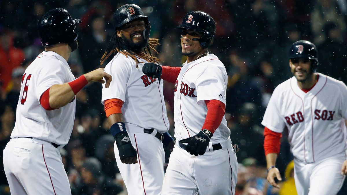 Boston Red Sox's Xander Bogaerts, center, celebrates his grand slam that also drove in, from left to right, Mitch Moreland, Hanley Ramirez and J.D. Martinez during the third inning of a baseball game against the Kansas City Royals in Boston, Monday, April 30, 2018. (AP Photo/Michael Dwyer)