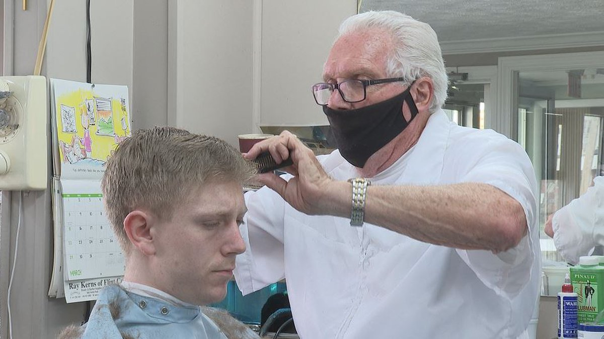 Owner of Mid- Michigan barber shop says he's received overwhelming support from the community...