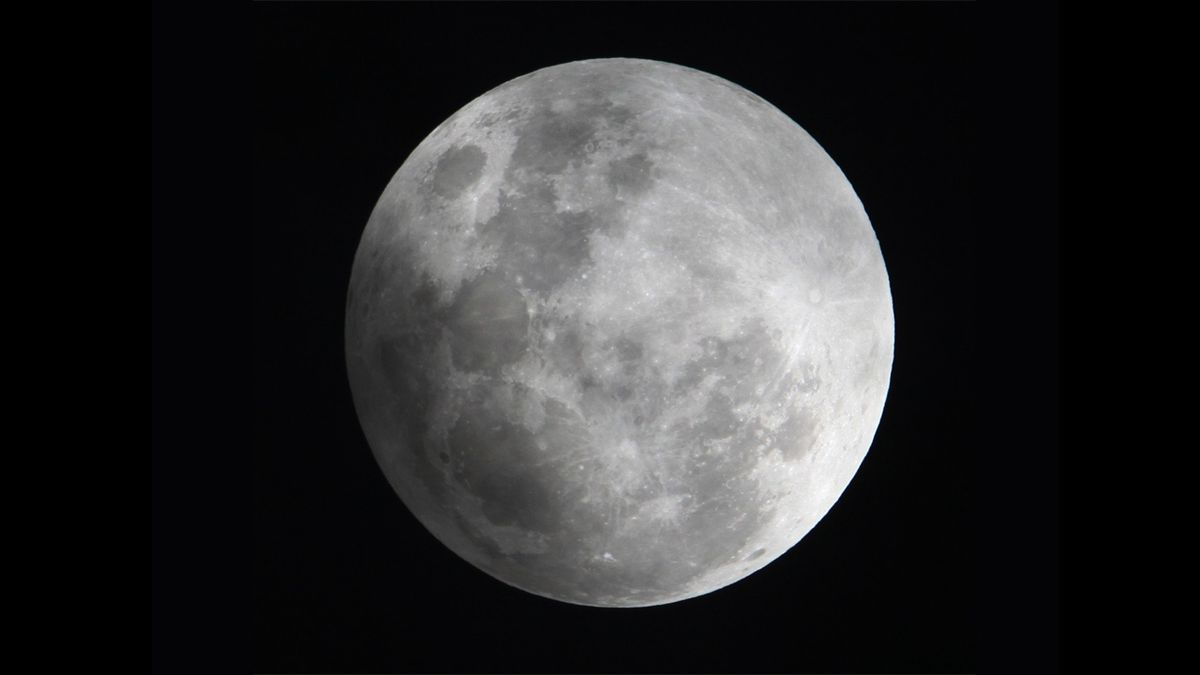 FILE - In this Monday Feb. 9, 2009 file photo, a faint shadow from the Earth is cast over part...