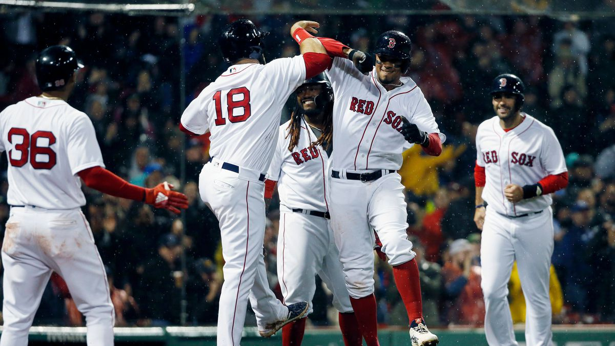 Boston Red Sox's Xander Bogaerts, center right, celebrates his grand slam that also drove in...