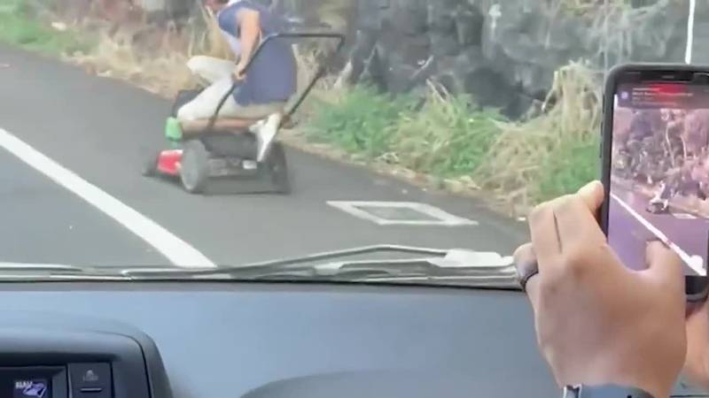 The suspect used a push lawnmower to get away, zooming past bumper-to-bumper traffic in the...