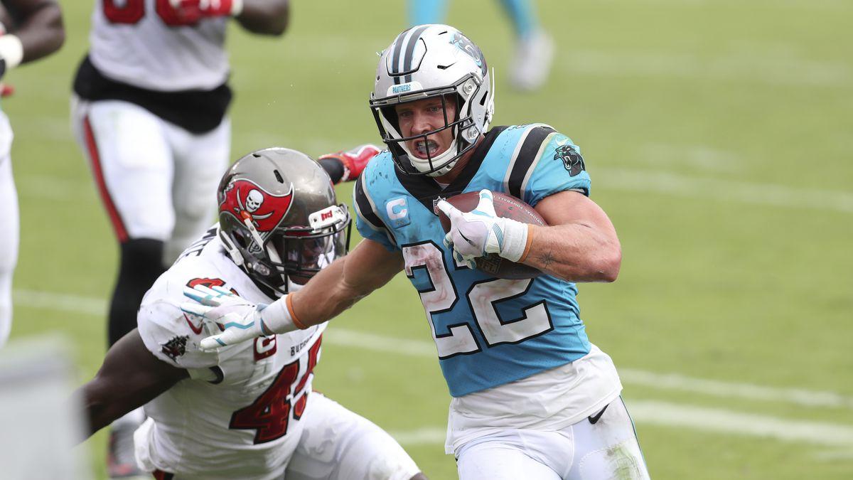 Carolina Panthers running back Christian McCaffrey (22) scores against the Tampa Bay Buccaneers...