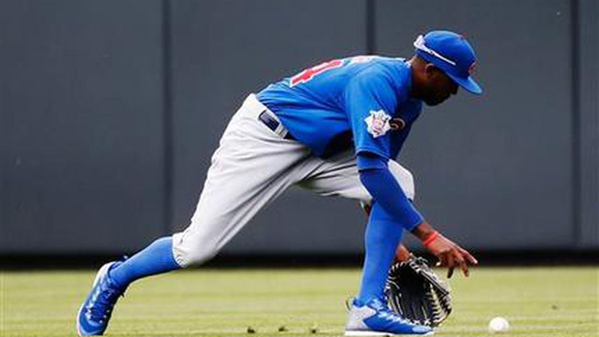 Chicago Cubs center fielder Dexter Fowler chases a fly ball hit by Colorado Rockies' DJ LeMahieu during the sixth inning of a baseball game on opening day, Friday, April 10, 2015, in Denver. (AP Photo/Jack Dempsey)