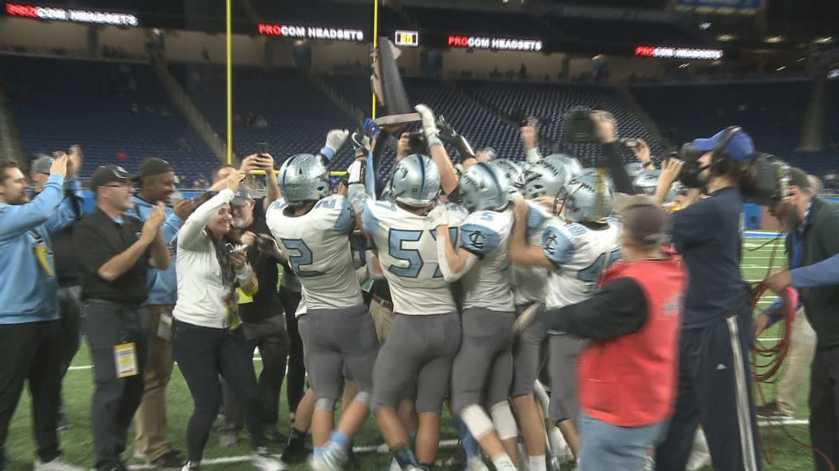 Lansing Catholic celebrates a Division 5 title in Detroit on Saturday (11-30-2019).