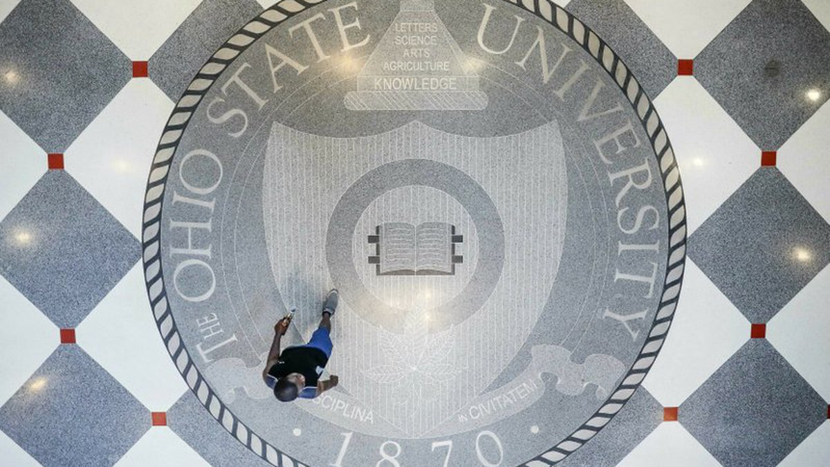 FILE - In this May 18, 2019 file photo, pedestrians pass through Ohio State University's...