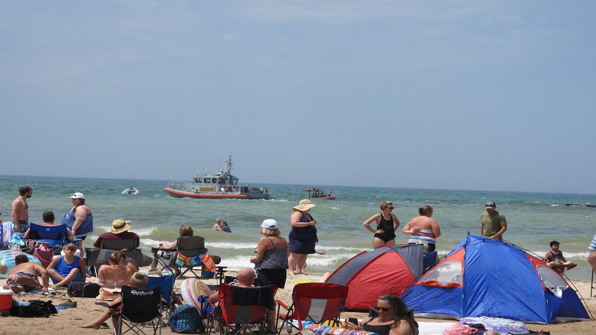 Emergency crews respond to Lake Michigan for a report of a teenager struggling in the water on...