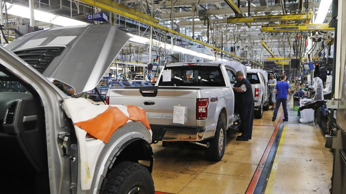 In this Sept. 27, 2018, file photo a United Auto Workers assemblymen work on a 2018 Ford F-150 trucks being assembled at the Ford Rouge assembly plant in Dearborn, Mich. The United Auto Workers union wants Detroit's three automakers to shut down their factories for two weeks to keep its members safe from the spreading coronavirus. But union President Rory Gamble says in an email to members obtained by The Associated Press that the companies were not willing to shut factories down. (AP Photo/Carlos Osorio, File)