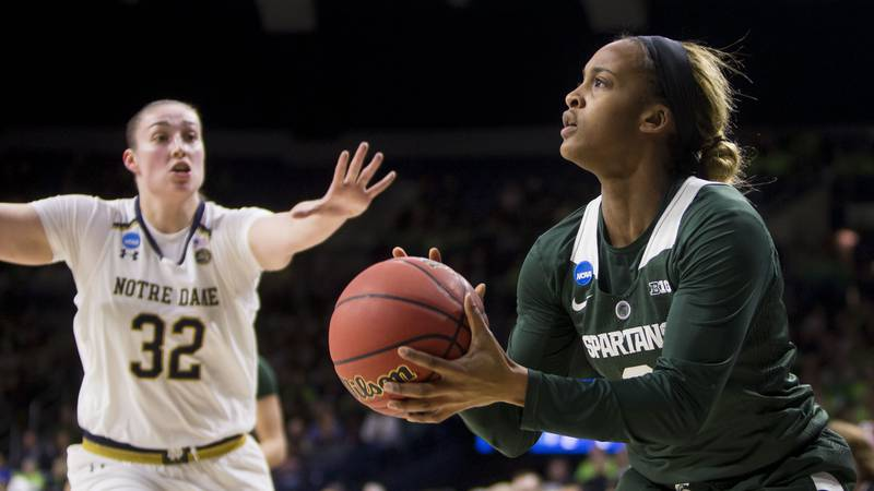 Michigan State's Shay Colley (0) shoots a 3-pointer as Notre Dame's Jessica Shepard (32)...