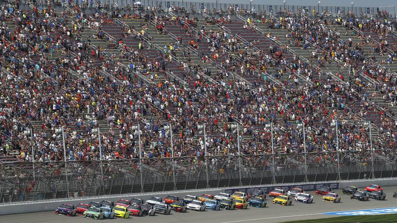 Pole sitter Denny Hamlin leads the field to the start line during a NASCAR Cup Series auto race...