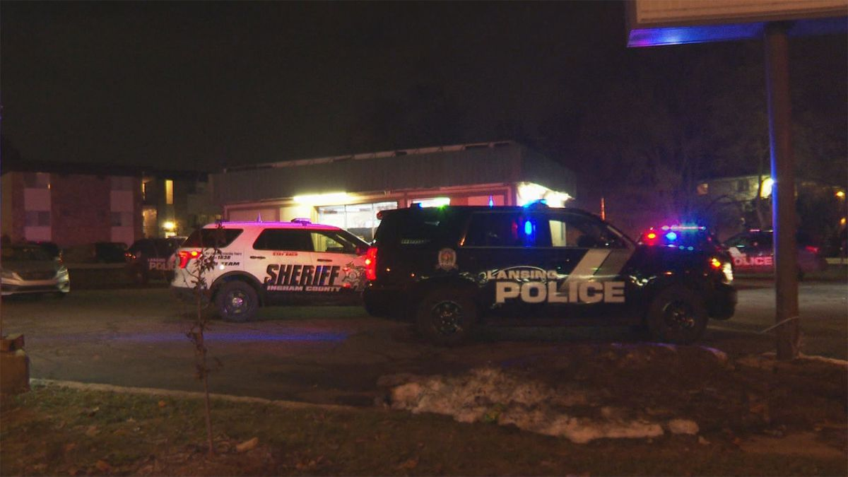 Police respond to robbery at Lansing liquor store on Tuesday, Nov. 19. (WILX)