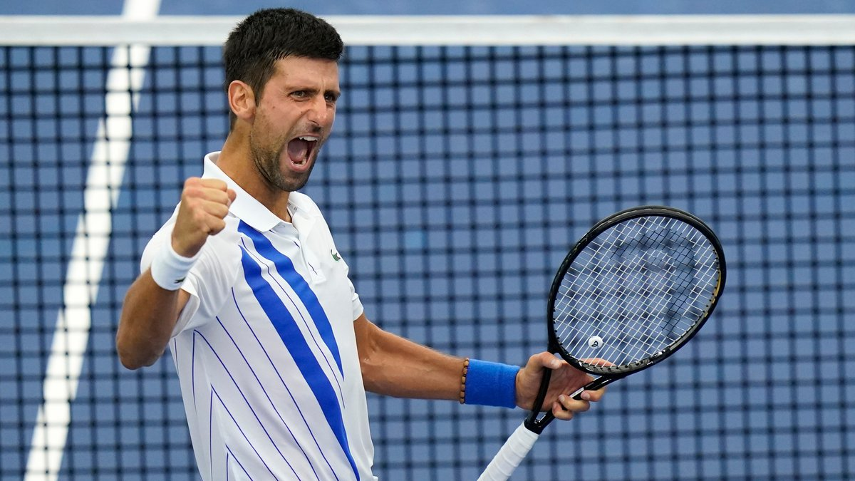 Novak Djokovic, of Serbia, reacts to winning his match with Milos Raonic, of Canada, during the...