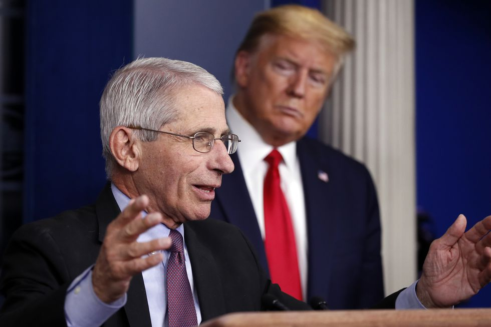 In this April 22, 2020 file photo, President Donald Trump watches as Dr. Anthony Fauci, director of the National Institute of Allergy and Infectious Diseases, speaks about the coronavirus in the James Brady Press Briefing Room of the White House in Washington. Fauci was the subject of a critical op-ed by trade adviser Peter Navarro.