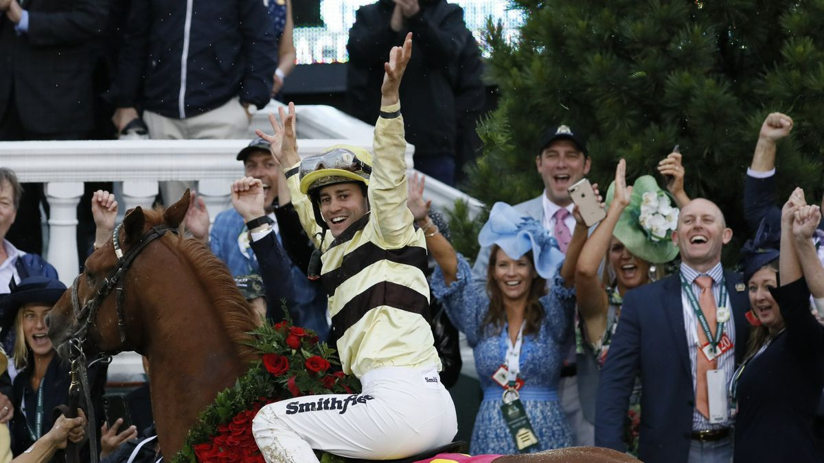 Flavien Prat celebrates after riding Country House to victory during the 145th running of the Kentucky Derby horse race at Churchill Downs Saturday, May 4, 2019, in Louisville, Ky. (AP Photo/John Minchillo)