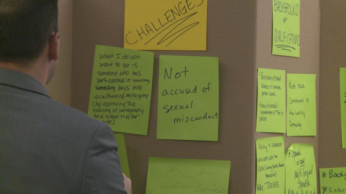 The Michigan Association of School Boards reads aloud input written on post-it notes from people who turned out to Tuesday's session (source, WILX).