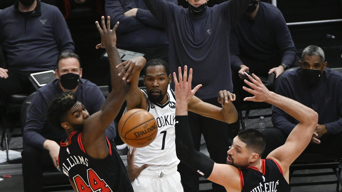 Brooklyn Nets forward Kevin Durant (7) passes the ball away from Chicago Bulls forward Patrick...